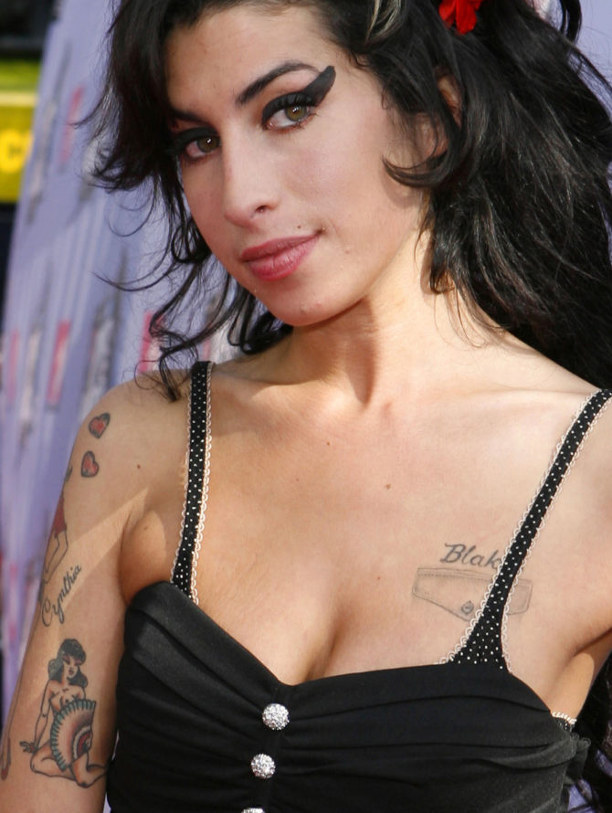 ** FILE ** Singer Amy Winehouse arrives at the MTV Movie Awards in Los Angeles, in this June 3, 2007, file photo. Winehouse will appeal a fine for marijuana possession, claiming Norwegian police made mistakes in the case. Winehouse and her husband, Blake Fielder-Civil, were arrested in the western city of Bergen on Oct. 18 and held overnight on charges of illegal drug possession. (AP Photo/Kevork Djansezian, file)