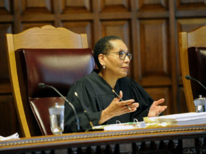 Sheila Abdus-Salaam, Associate Judge of the Court of Appeals, listens to oral arguments on whether criminal defendants should be allowed to use allegations made in civil rights lawsuits against police witnesses to question their credibility during cross-examination at the Court of Appeals on Wednesday, June 1, 2016, in Albany, N.Y. (AP Photo/Hans Pennink)