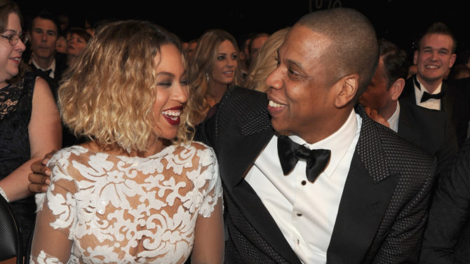 LOS ANGELES, CA - JANUARY 26:  Singer Beyonce (L) and rapper Jay-Z attend the 56th GRAMMY Awards at Staples Center on January 26, 2014 in Los Angeles, California.  (Photo by Kevin Mazur/WireImage)