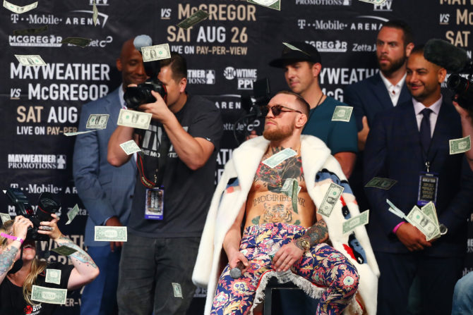 NEW YORK, NY - JULY 13:  Conor McGregor looks on as money rains down during the Floyd Mayweather Jr. v Conor McGregor World Press Tour event at Barclays Center on July 13, 2017 in the Brooklyn borough of New York City.  (Photo by Mike Stobe/Getty Images)