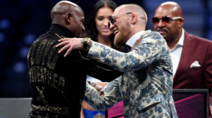LAS VEGAS, NV - AUGUST 26: (L-R) Floyd Mayweather Jr. and Conor McGregor shake hands after Mayweather's 10th round TKO victory in their super welterweight boxing match on August 26, 2017 at T-Mobile Arena in Las Vegas, Nevada. (Photo by Ethan Miller/Getty Images)