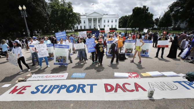 Supporters of Deferred Action for Childhood Arrivals program (DACA), layout a banner as they demonstrate on Pennsylvania Ave. in front of the White House in Washington, Sunday, Sept. 3, 2017.  After months of dragging his feet, President Donald Trump will announce on Tuesday his plans for DACA program, which has given nearly 800,000 young immigrants the ability to work legally in the country and a reprieve from deportation.(AP Photo/Pablo Martinez Monsivais)